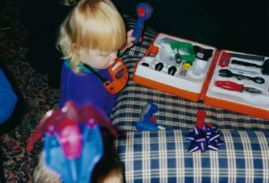 Above: Nell Carpenter at age 2 with her first tool box!